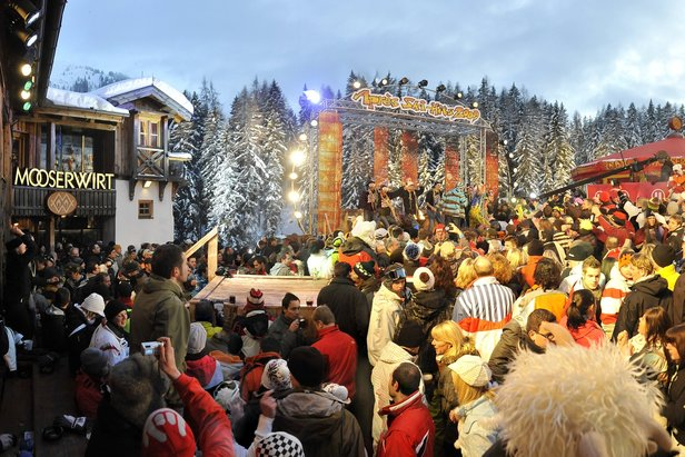 Skiers gather outside the Mooserwirt in St. Anton am Arlberg, Austria