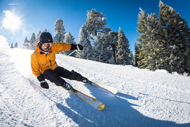 Skier enjoying the warm weather and great conditions at Big Bear Mountain Resorts in Southern California.