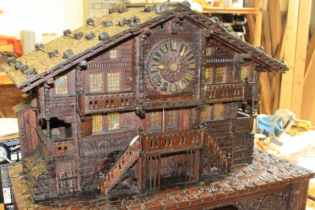 This wood clock with a music box is currently being restored at Ski Country Antiques & Home and is a staff favorite.  - © Ski Country Antiques & Home