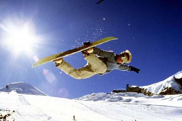 A snowboarder catching air and performing a grab at Saas Fee, in the Valais region of Switzerland.  - © Saas-Fee