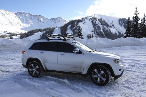 Thule's 6-ski roof rack on a 2014 Jeep Grand Cherokee, with Arapahoe Basin in the background.
