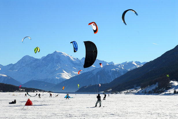 Snowkiting on frozen lake of Reschensee in South Tyrol