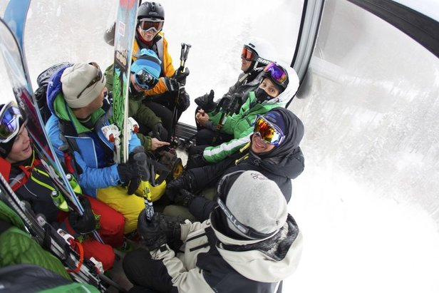Skiers pack the new gondola on their way up the mountain