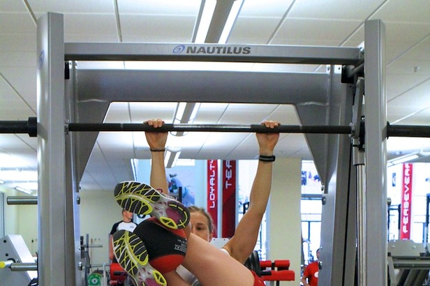 Ski Exercises: Weighted Hanging Leg Raises With Twist- ©OnTheSnow.com