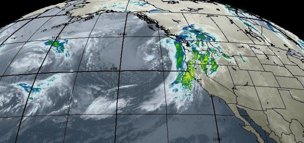 A storm approaches the west coast from the Pacific Ocean.