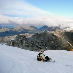 Snowboarder taking in the views at Coronet Peak, New Zealand - ©Adrian Pua