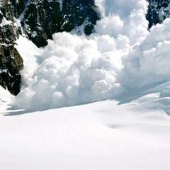 Powerful avalanche exploding down the mountain