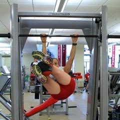 Ski Exercises: Weighted Hanging Leg Raises With Twist - ©OnTheSnow.com